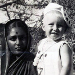 A Polish child in the arms of an Indian woman.