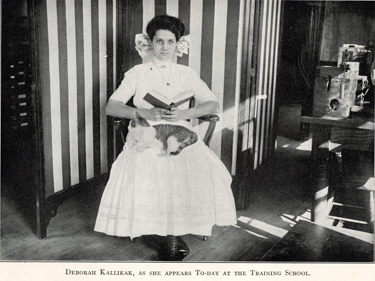 "In a photo in Goddard's book, ""Deborah Kallikak"" is shown sitting demurely holding a book."
