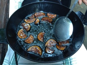 Eggplants sizzle on an outdoor grill