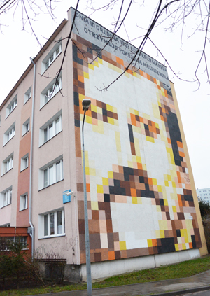 Lech Wałęsa's face is painted on the wall of the building in Gdańsk, Poland, where he lived in the 1980s.