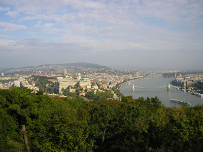 Panorama of Budapest. From left to right: The Castle Hill (Várhegy), the Chain Bridge (Lánchid) that spans the river Danube, and the dome of the Hungarian Parliament Building.