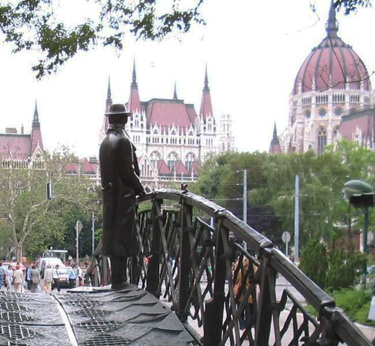 A statue of Imre Nagy (1896-1958) gazes at the Hungarian Parliament Building. Nagy was executed by Communist authorities for his role in the 1956 Hungarian Revolution.
