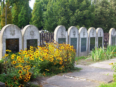 The view over the walls of the Jewish cemetery. These stones line the entire space, with daisies and tulips filling the spaces in between.