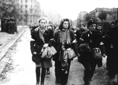 The AK was unusual in that it included a high number of women, working as nurses, explosive experts and runners. Here they leave the city as prisoners of war in October 1944.