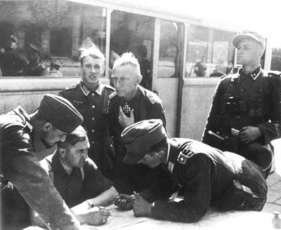 Heinz Reinefarth (centre standing) ordered the massacre in Wola. Later achieved high office in Germany and never charged for his crimes.