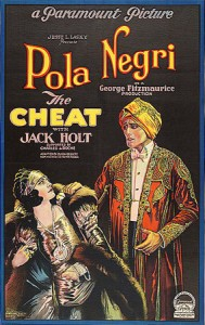 "The silent film ""The Cheat"" (1923) is a remake of Cecil B. DeMille's 1915 hit using the same script. This one starred Pola Negri, draped in fur and jewels in the film poster. She's being grabbed by Charles de Roche, who's dressed as an Indian prince. This version was produced by Famous Players-Lasky and distributed by Paramount Pictures."