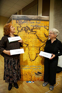 "Two friends stand in front of a map of Africa, on which attendees wrote their names where their settlements were located; the title reads ""We were there..."""