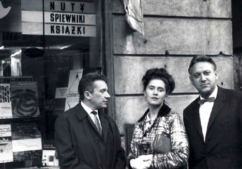 Mieczysław Weinberg with Russian director Kirill Konrachine and Mrs. Kondrachine in an undated photo. A sign behind them announces, Music Songbooks Books