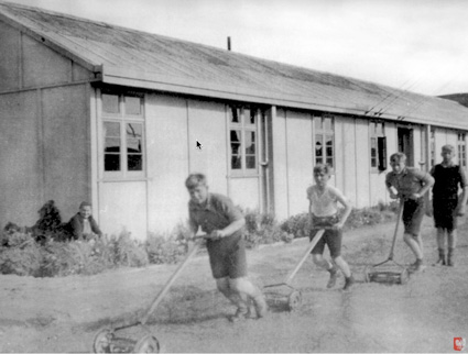 Pahiatua, NZ: And now some older boys try their hand at a mower.PHOTO courtesy of the Kresy-Siberia Virtual MuseumExhibition: Daily Life