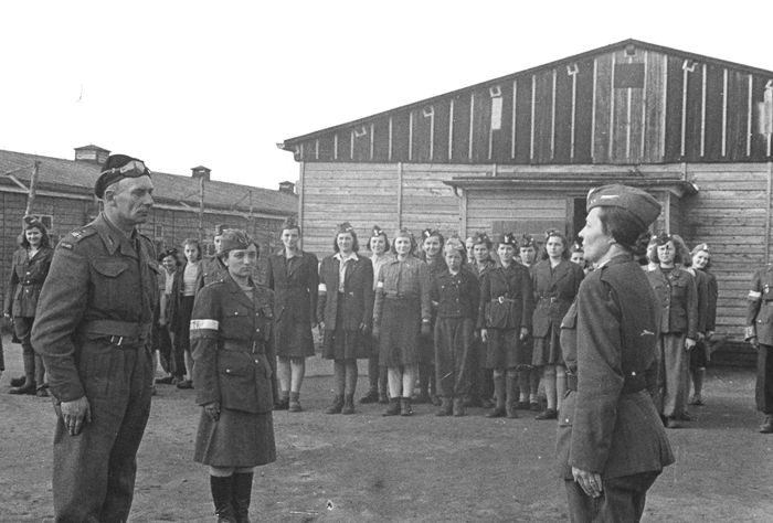 Last roll call at Stalag VI-C: Note the Polish red-and white-armbands on many of the prisoners' arms – meaning they fought in the Warsaw Uprising.