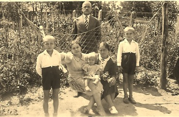 The Wiacek family in their graden in Poland