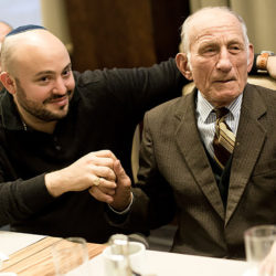 Jozef Jarosz, who saved 14 Jews during the Holocaust, meeting Jonny Daniels, left, in Warsaw in November 2016. (Photo courtesy of From the Depths)